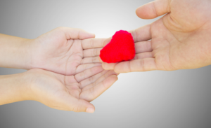 Hand Passing Heart To Cupped Hands
